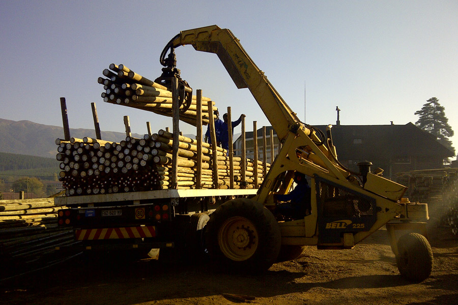 Loading-CCA-Poles-to-Deliver-toa-customer